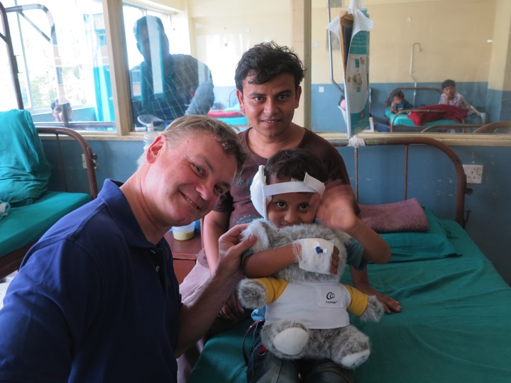 Dr. David Foyt with Nepalese boy who received donated cochlear implant.